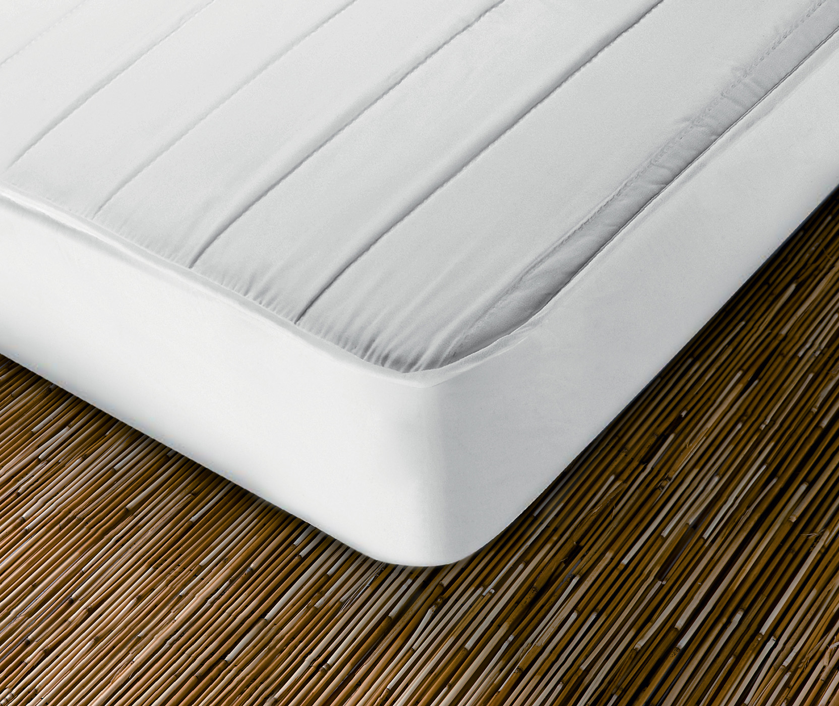 What is a mattress protector and what is it used for?